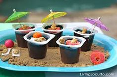 easy dessert for a pool party - pudding cups with teddy grahams and umbrellas on top.