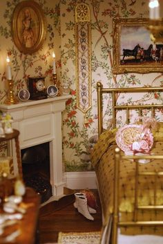 Beautiful English country bedroom with a wealth of pictures, small photos, candlesticks, clock - and of course that gorgeous wallpaper.