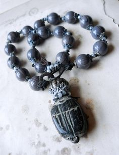 Richelle Hawks/shipwreckdandy - Beaded Necklace Scarab - Grey Glass, Indian Metal, clay, leather