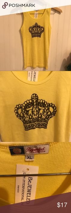 NWT BeJEWELED tank top NWT Bejeweled by Susan Fixel yellow tank top with crown in brown with jewels.  Size XL, but seems more like M or L. BeJeweled Tops Tank Tops