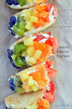 """Not sure if this counts as """"healthy"""" but it does look delicious! Mini Fruit Tacos are healthy and delicious alternatives to rainbow desserts! Cinnamon Sugar Tortillas with a Cream Cheese Filling and ALL the Fresh Fruit! Fruit Taco Recipe, Fruit Recipes, Cooking Recipes, Strawberry Recipes, Rainbow Desserts, Rainbow Fruit, Rainbow Theme, Healthy Snacks, Healthy Recipes"""