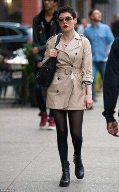 Fashion or fraud: Rose McGowan was spotted out and about in New York on Friday in a very short cream trench coat that barely reached her thighs and certainly wouldn't keep her warm or dry in inclement weather