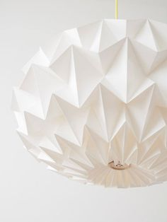 Signature White Paper Origami Lampshade .... by Studio Snowpuppe...This pendant lamp is handfolded from only three sheets of paper — look at the gorgeous results! The light glowing through the myriad of recessed triangles is the perfect centerpiece for a dining room.