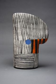 Originally trained as a painter, in 1989 Nina Else started a transition from painting and collage to ceramics, but has managed to keep a foot in both camps. All her work is hand-created, using colorful low-fire glazes and stains, acrylic paint, and the masonry epoxy PC7.