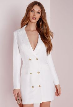 Look fierce this season in this White blazer dress. In a figure flattering fabric this all white number with long sleeves, pocket front, silk collar and gold button feature is seriously chic. Team with black strappy heels and matching clutc...