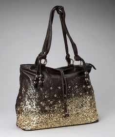 Sashay through every day with this glittering shoulder bag. A sequin-dusted front and a bevy of interior compartments mean that carrying the essentials can be a chic affair. 20'' W x 14'' HVegan leatherImported