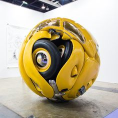 Indonesian artist Ichwan Noor has spherized a 1953 Volkswagen Beetle into a globular mass of shiny yellow.