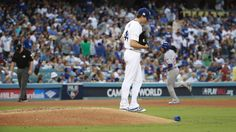 October 15, 2017:  NLCS Game 2: Cubs-Dodgers 4 to 1, Dodgers.   Dodgers starting pitcher Rich Hill looks down as Cubs shortstop Addison Russell rounds the bases after his home run in the fifth inning.