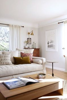 our sun-filled living room with warm woods and white | coco kelley