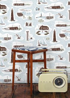 Mini Moderns take a stroll along the shingle and explore the magical landscape of Dungeness. The first wallpaper in the 2014 Hinterland collection, Dungeness features a mass of shingle, punctua...