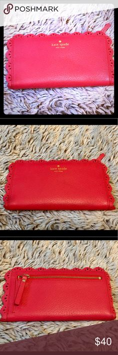 Kate Spade Leather Wallet Kate Spade Leather Wallet  Beautiful red leather, has many a compartments including several card slots, ID window, bill compartment, Large zippered compartment & possibly a checkbook  Excellent Condition with the exception of a small tear in Leather you can barely see when opened (see pic) kate spade Bags Wallets