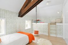 This adorable contemporary kid's room is a playful style wonderland. A child-sized loft in the back makes a sweet tucked-away play space. A hammock swing waits to be curled up in. And the green, white and orange palette is one that stretches across genders and ages.