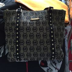 100% authentic Michael kors bag Monogram style with black studded leather and black leather handles Michael Kors Bags Totes
