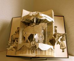Altered Book Sunday Afternoon Carousel Ride by Raidersofthelostart, via Etsy.