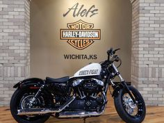 The 2014 Harley-Davidson® Sportster® Forty-Eight® model XL1200X is one of the garage custom motorcycles in the Harley® Dark Custom™ line. This bike cruises down the road with a 1,200 cubic centimeter Evolution® engine – an engine with a true Harley-Davidson soul. The front end of the bike looks beefy with its fat MT90 tire. The Harley Sportster Forty-Eight model look is enhanced with the lowered front and rear suspension.