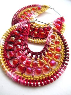 Crocheted hoops with beads in vanilla and by BohemianHooksJewelry, $15.00