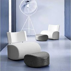 Apollo is a sculptural rocking armchair and comfortable lounger with removable cushions. http://vurni.com/apollo-sculptural-rocking-armchair/