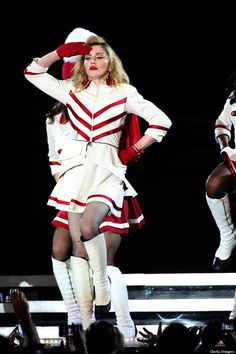 MDNA - Madonna on tour - Singing Express Yourself and marching. She was twirling a baton at one point too. Loved it!