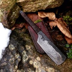 Hand forged from 1084 and with 120 layers. Handle is wrapped with hemp that has been brushed with a waterproof glue. Comes with vegetable tanned leather sheath for safe storage. Measures with a blade.