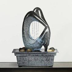 This LED-illuminated indoor/outdoor water tabletop fountain has the look of faux black marble stone.