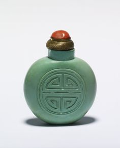A nineteen-century Chinese turquoise snuff bottle, engraved with a shou character, symbol of longevity. (British Museum)