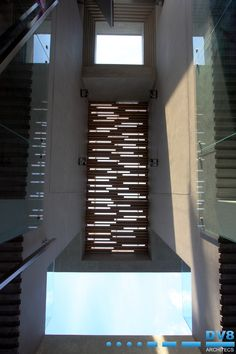 Entrance roof detail. Combination of stepped concrete skylight and staggered timber screen creating interplay of light and shadow.