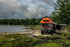 Beautiful lake side tent topped camping spot Photo from Tepui Customer Galley