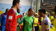 Peter Odemwingie (C) of Nigeria greets Emir Spahic (R) and Asmir Begovic of Bosnia and Herzegovina