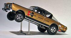 Sven's World Of Wheels featuring custom built Hurst Hemi Under Glass Barracuda model cars Hurst Oldsmobile, Plastic Model Cars, Plymouth Barracuda, Mopar, Diecast, Monster Trucks, Glass, Collection, Drinkware