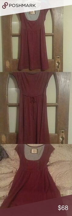 """Free People Dress Precious Free People rayon dress with empire waist and cap sleeves. Dress has button plaquette on chest and a burgundy ribbon ties in the back. Beautiful burgundy color. Size M. Never worn. I am 5'6"""" and dress hits at my knees. Free People Dresses Midi"""