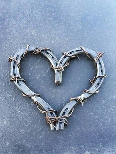 Barbed wire wrapped horseshoe heart, available for purchase $30 :)