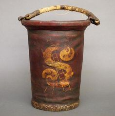 A 19th century American leather Fire bucket with the original polychrome painted decoration. Marked with crossed ladders over an S . Wear, lacks most of the
