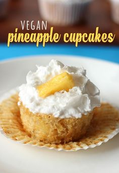 Enjoy a little blast of the tropics with these EASY vegan pineapple cupcakes, topped with fluffy coconut whip cream!