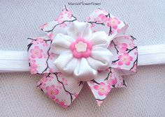 This listing is for a baby/toddler handmade KANZASHI headband. A gorgeous handmade flower, made of grosgrain ribbon, measures apprx. 4cm(1-1/2),decorated with cherry blossom ribbon. The headband itself is made of soft elasticated band that is delicate for a babys head. Newborn- 33cm-13  0-6 months - 35cm-14  6-12 months- 39cm-15-1/2  12 months - 24 month- 40 cm- 16 All headbands are elasticated, so will stretch as your little one grows to the next size.   Stunning hair accessories, made in…