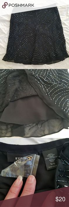 Gorgeous Express black silk beaded skirt This skirt is delicate and stunningly beautiful. The beading is swirling all around the lined silk skirt. NWOT Express Skirts