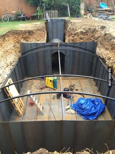 Guy ripped his garden up and built an underground mancave.