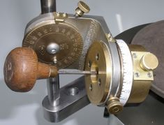Engraver holding fixture that will allow setting of a left or right angle and a up or down angle.