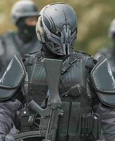 I'm currently trying to find out wtf this unit is. Any ideas? Futuristic Helmet, Futuristic Armour, Military Armor, Military Gear, Military Soldier, Military Life, Combat Suit, Tactical Helmet, Mecha Suit