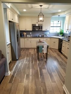 From the flooring, to the ivory cabinets, and stainless steel appliances, my kitchen turned out exactly how I pictured; now to cook...