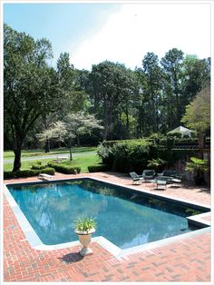 love the shape of the pool an the brick surround and the DIVING BOARD!!