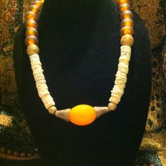 Ostrich egg shell, Krobo recycled glass, brass and copal amber necklace $60
