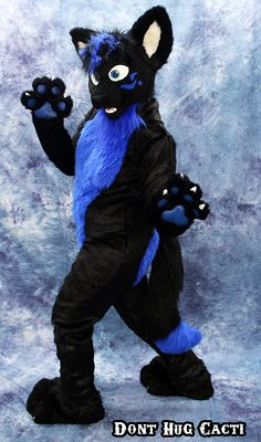 I have always been a fan of black and blue! Such a good suit! By: Don't Hug Cacti