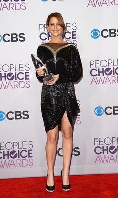 Jennifer Lawrence with one of her awards at the 2013 People's Choice Awards held at Nokia Theatre L.A. Live on 01/09/12. I love her dress! Perfect for her figure.