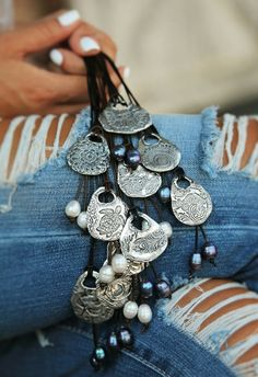 See our leather and pearl sterling silver necklaces on our website HappyGoLickyJewelry.com and save 10% right now with coupon code PIN10. #HappyGoLickyJewelry #handmade #etsyjewelry ##sterlingsilver #boho #bohochic #bohojewelry #bohemian #festivalstyle