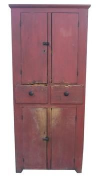 "Early 19th century Pennslyvania four door Storage Cupboard, with two tall center drawers, square head nailed, with original red paint, the doors are single plank doors, with scratch beading around door opening, all original hardware, with a chamfer top molding around the case. circa 1840 Measurements are: 37 3/4"" wide x 23"" deep x 87"" tall"