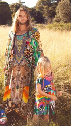 Beautiful boho man and child. I don't even care that he's wearing a dress, lol.