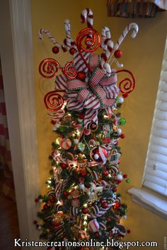 Kristen's Creations: Christmas In The Kitchen     My gingerbread tree...I decorated the top with candy canes and shiny red curly sticks.