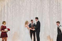 December winter barn wedding close to Salem, Oregon. Green Villa Barn. Twinkle Light Backdrop ceremony