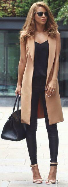Leather pants & camel maxi vest.