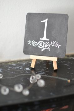 10 Chalkboard Table Numbers with Wooden Mini Easel - Hand Lettered - Wedding Table Number Signs by dreamalittlehandmade on Etsy Chalkboard Centerpieces, Chalkboard Table Numbers, Chalkboard Wedding, Chalkboard Signs, Wedding Table Decorations, Wedding Table Numbers, Wedding Tables, Wedding Signs, Diy Wedding